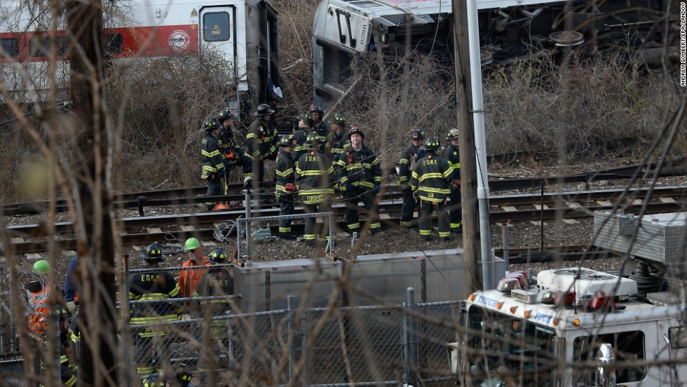 Firefighters and rescue personnel work at the scene of the derailment.