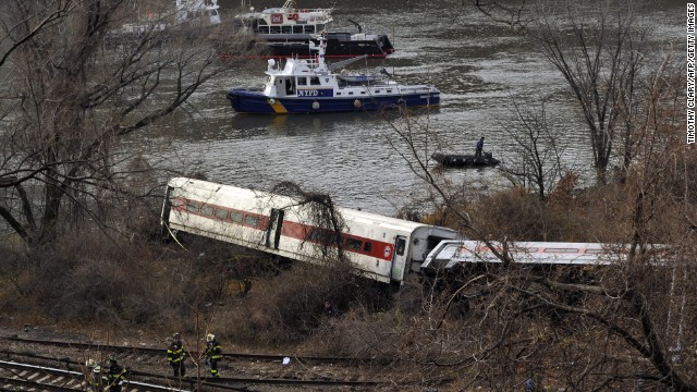 Emergency crews at the scene of a commuter train wreck on Dec 1, 2013 in the Bronx borough of New York. The train bound for New York's Grand Central Station derailed in the Bronx Sunday with at least four people reported dead after several rail cars left the tracks near the Spuyten Duyvil railroad station. The southbound train was traveling from Poughkeepsie to Grand Central Terminal when the accident occurred. AFP PHOTO / TIMOTHY CLARY        (Photo credit should read TIMOTHY CLARY/AFP/Getty Images)