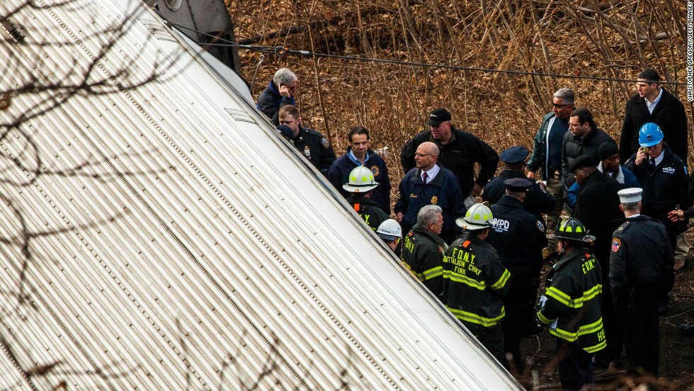 Cuomo inspects the damage along with emergency crews.