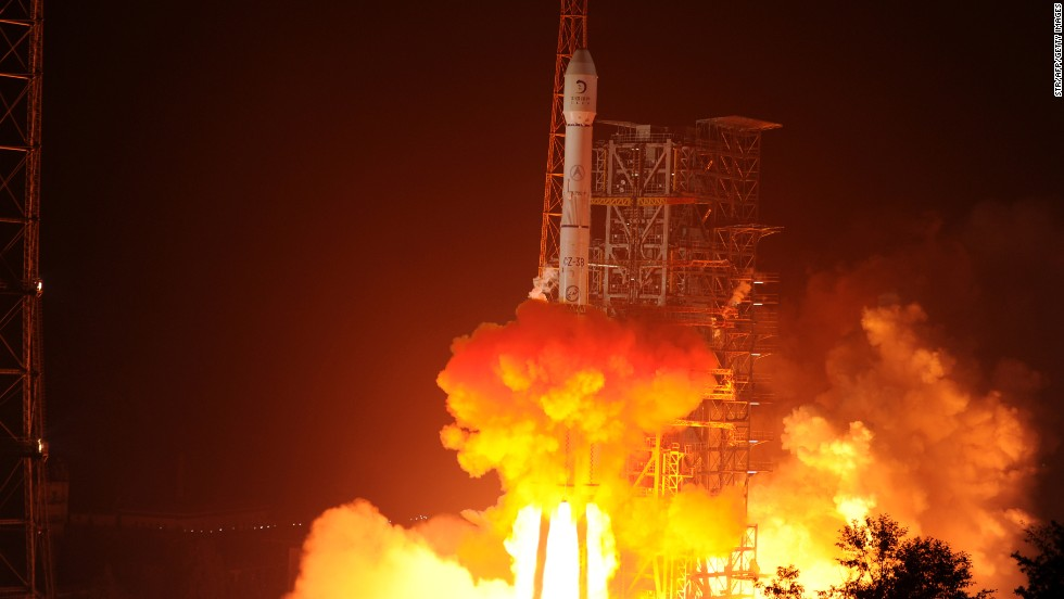A rocket carrying the Jade Rabbit -- China's first lunar rover -- blasts off from the Xichang Satellite Launch Center in the southwest province of Sichuan, China, on December 2, 2013.