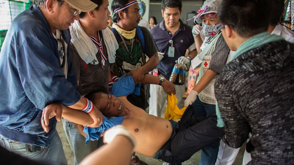 An injured protester is carried on December 1.