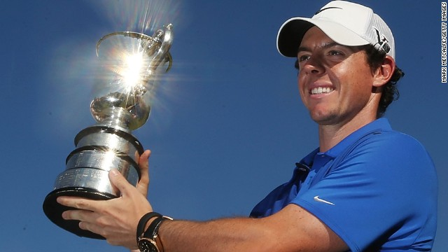 Rory McIlory gets his hands on a trophy at last in 2013 after a dramatic one-shot victory over Adam Scott at the Australian Open.