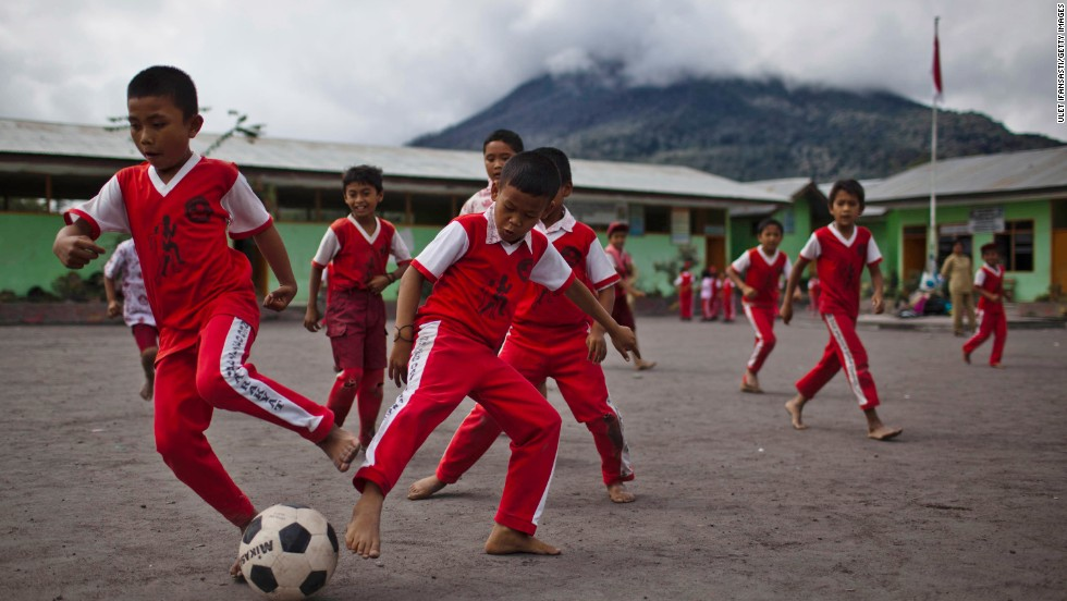 Children play football at their school in Kuta Rakyat village in North Sumatra, Indonesia. Fewer than 1% of Indonesian students performed in the top performance bands for mathematics.