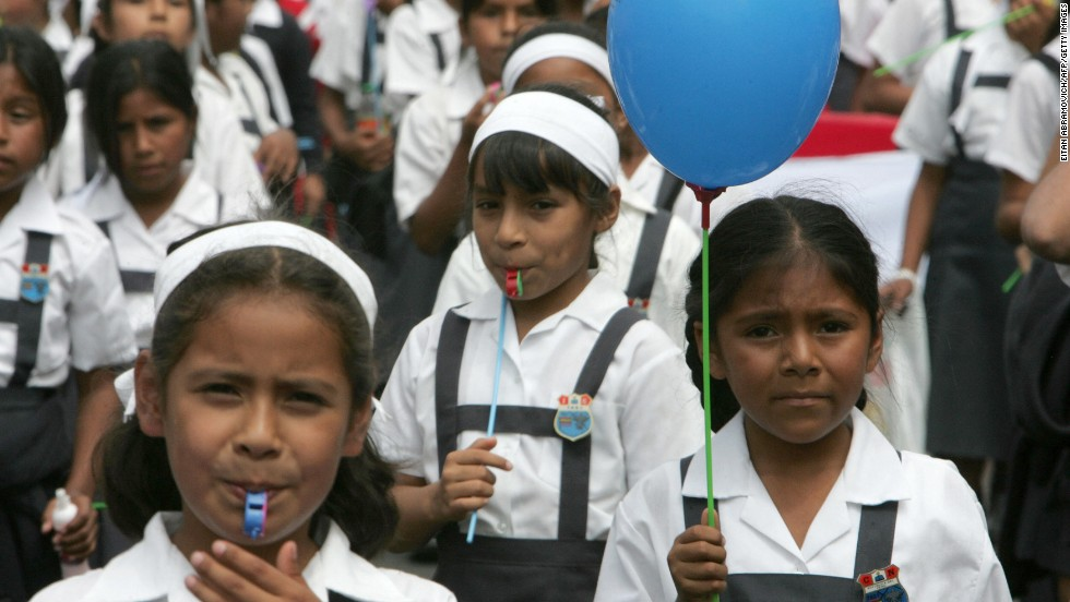 Schoolchildren take part in a protest march in Peru's capital, Lima, in 2007, demanding better quality and greater investment in education. Peru's math score in the PISA study was the equivalent of about six years schooling behind the top performer, Shanghai.