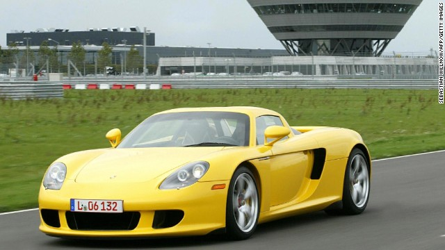 A new Porsche Carrera GT model is test driven at the Leipzig Porsche factory 06 October 2003. The new model, which can reach 200km/h in 9.9 seconds, will be available before the end of October. A limited hand-made edition will be available for Euro 500.000 (USD 584.000). AFP PHOTO DDP/SEBASTIAN WILLNOW GERMANY OUT (Photo credit should read SEBASTIAN WILLNOW/AFP/Getty Images)