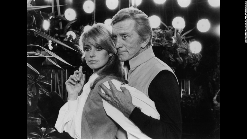 "Fawcett is held by Kirk Douglas in a scene from the film ""Saturn 3"" in 1980."