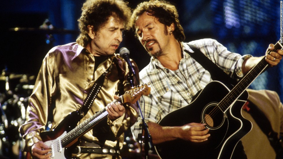 Dylan and Bruce Springsteen perform together in 1990.