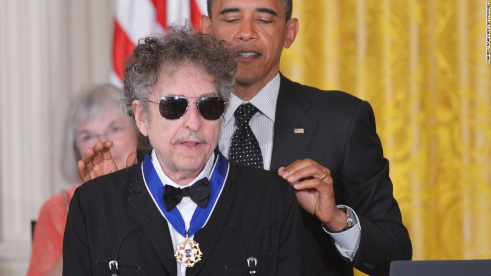 "President Barack Obama presents the Presidential Medal of Freedom to Dylan in the East Room of the White House in 2012. The award is the country's highest civilian honor. ""I remember, you know, in college, listening to Bob Dylan and my world opening up, 'cause he captured something about this country that was so vital,"" Obama said."