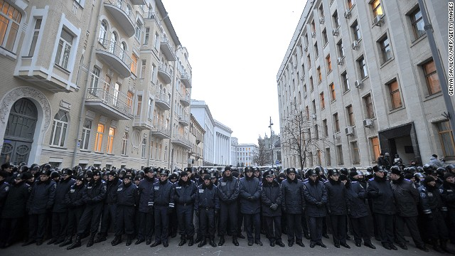 Ukrainian police block the street in front of presidential offices in Kiev on Tuesday..
