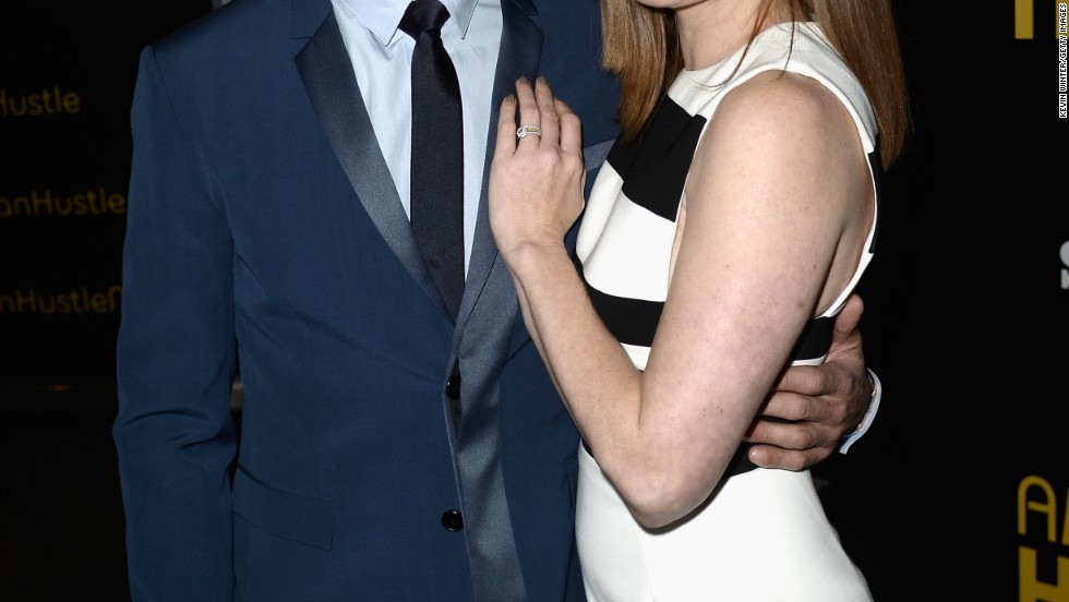 """American Hustle"" co-stars Jeremy Renner and Amy Adams hustle onto the red carpet of the movie's December 3 special screening in Los Angeles."