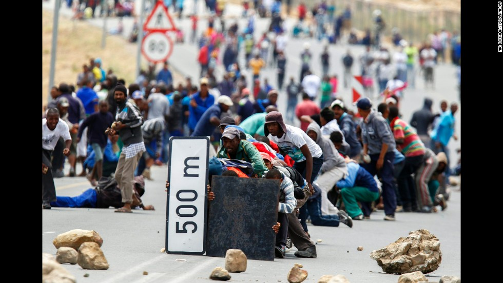 <strong>January 10:</strong> Protesters advance on police in De Doorns, South Africa. Farmworkers across the Western Cape were on strike at the time, demanding that their wages of 65 rand a day ($7.50 U.S.) be doubled.