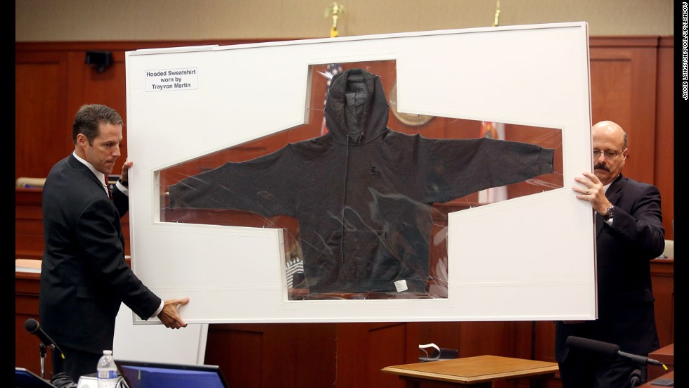 <strong>July 3:</strong> Assistant State Attorney John Guy, left, and Assistant State Attorney Bernie de la Rionda display the hooded sweatshirt worn by teenager Trayvon Martin on the night he was shot by neighborhood watch captain George Zimmerman in Sanford, Florida. A jury found Zimmerman not guilty of second-degree murder.