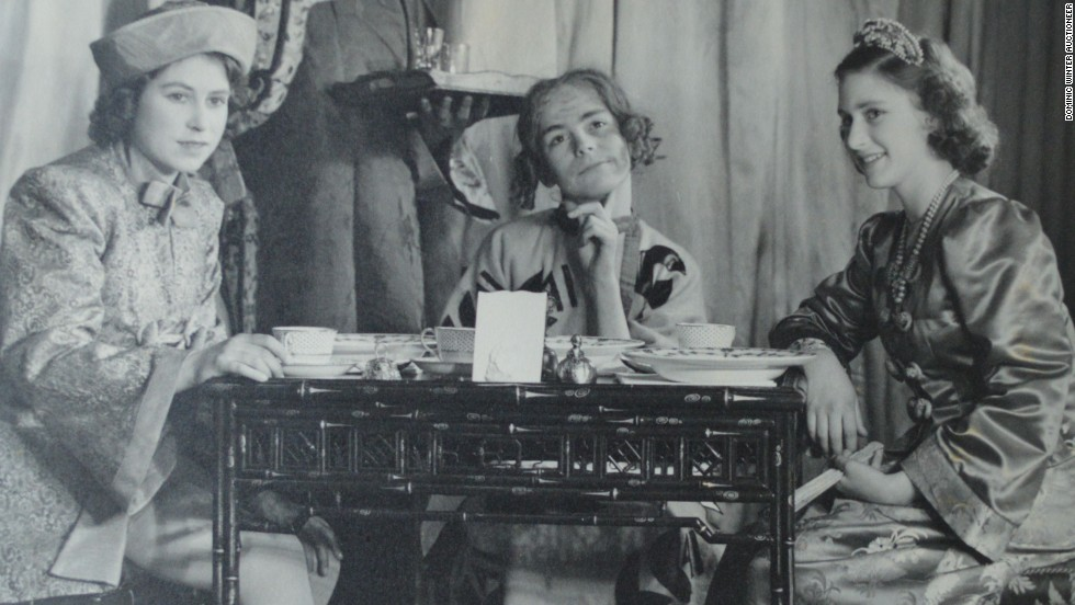 Princess Elizabeth (L) with Cyril Woods (C) and Princess Margaret (R) in Aladdin.