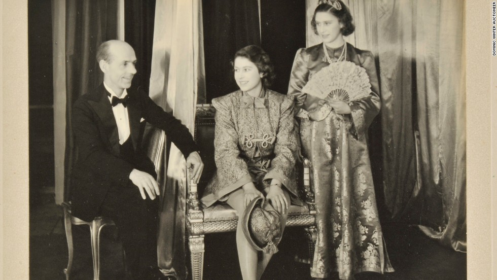 Princess Elizabeth (C) and Princess Margaret (R) on stage in a photograph signed in 1943.