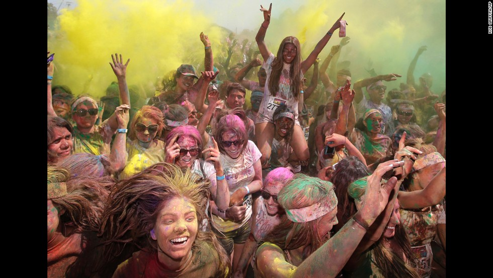 <strong>February 10:</strong> People celebrate in clouds of colored dust after the Color Run 5K in Sydney.