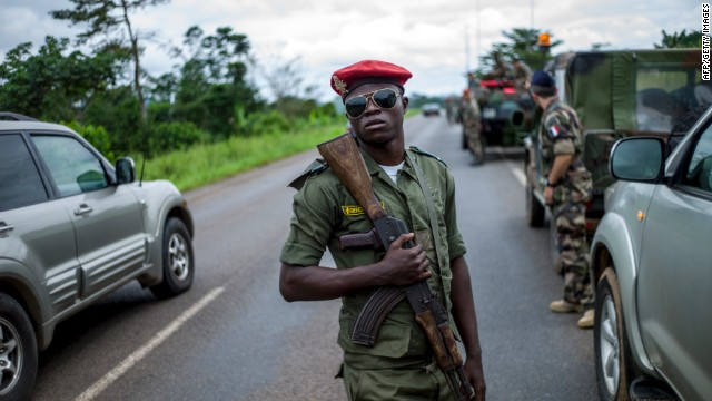 A Cameroonian soldier holds an assault rifle as Cameroonian military escort French troops driving from Douala to Central African Republic on December 4, 2013.