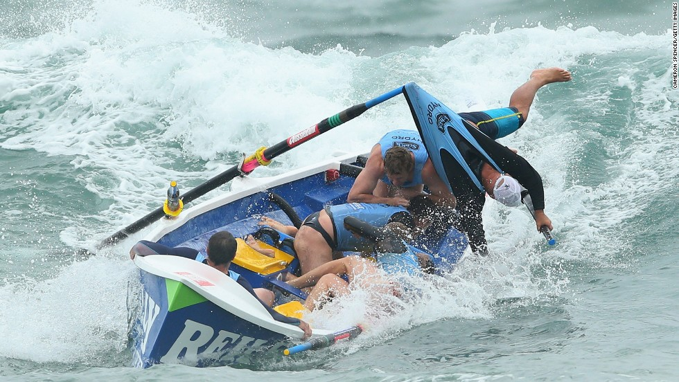 The Bungan surf life-saving crew loses control of their boat during the Ocean Thunder Pro Surf Boat Series on February 2 at Dee Why Beach in Sydney, Australia.