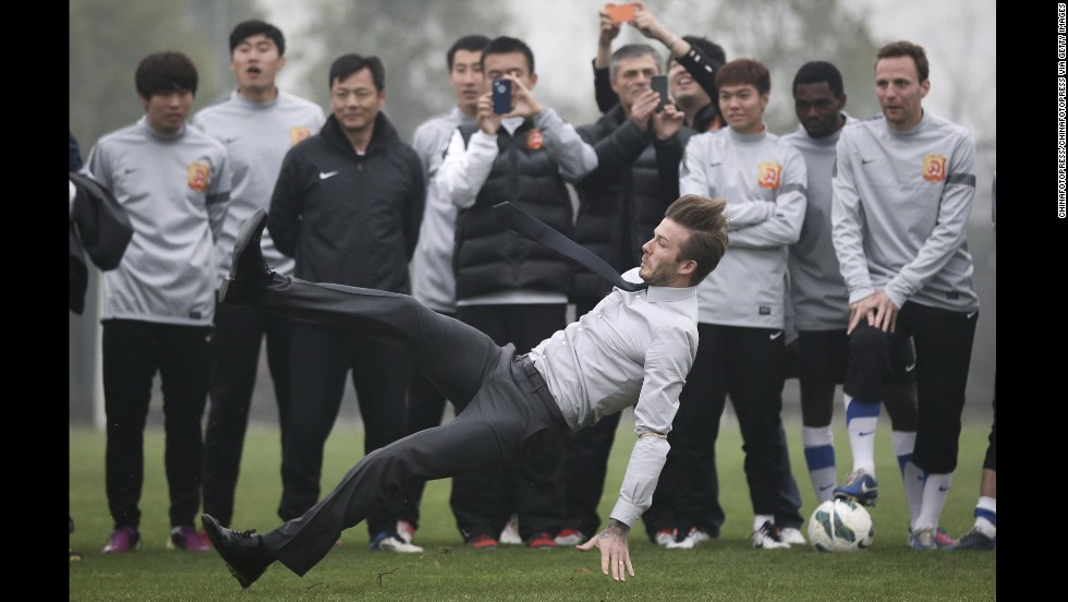 David Beckham falls during his visit with the Wuhan Zall Football Club on March 23 in Wuhan, China.