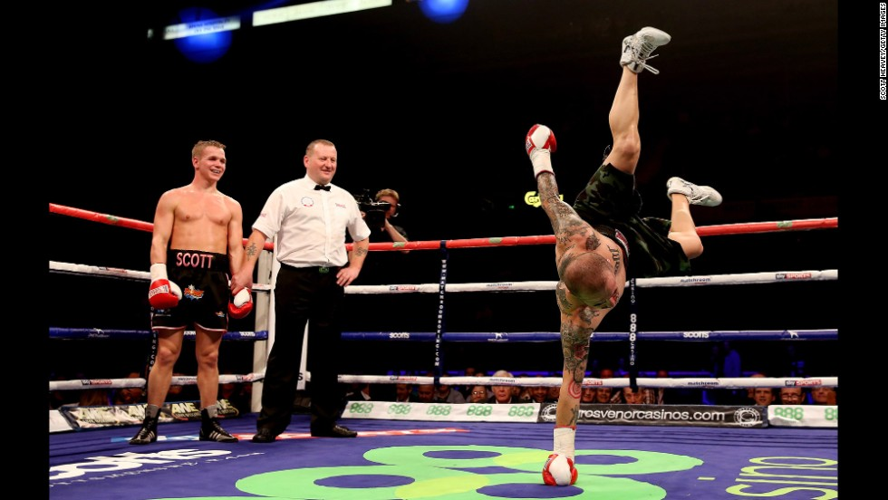 Antonio Rodriguez dances in the ring as Scott Jenkins celebrates his victory during their lightweight bout on October 26 at Motorpoint Arena in Sheffield, England.