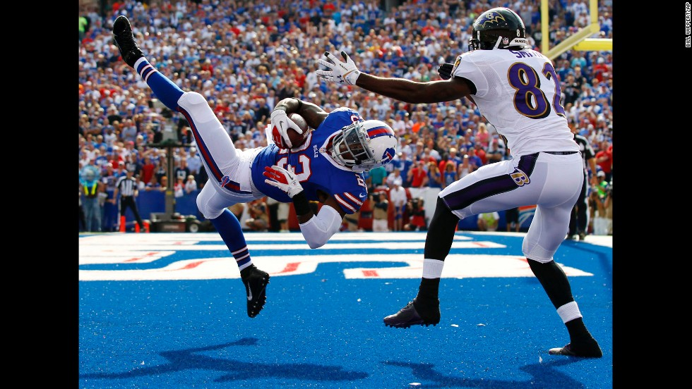 Buffalo Bills free safety Aaron Williams intercepts a pass intended for Baltimore Ravens wide receiver Torrey Smith during the second half of their game in Orchard Park, New York, on September 29. The Bills won 23-20.