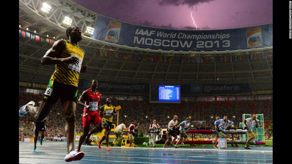 A lightning bolt strikes as Usain Bolt of Jamaica wins the 100-meter final in the IAAF World Championships on August 11 at Luzhniki Stadium in Moscow. Bolt timed a season's best 9.77 seconds.