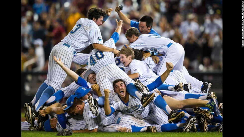 UCLA celebrates after defeating Mississippi State 8-0 in Game 2 to win the championship in the NCAA College World Series on June 25 in Omaha, Nebraska.