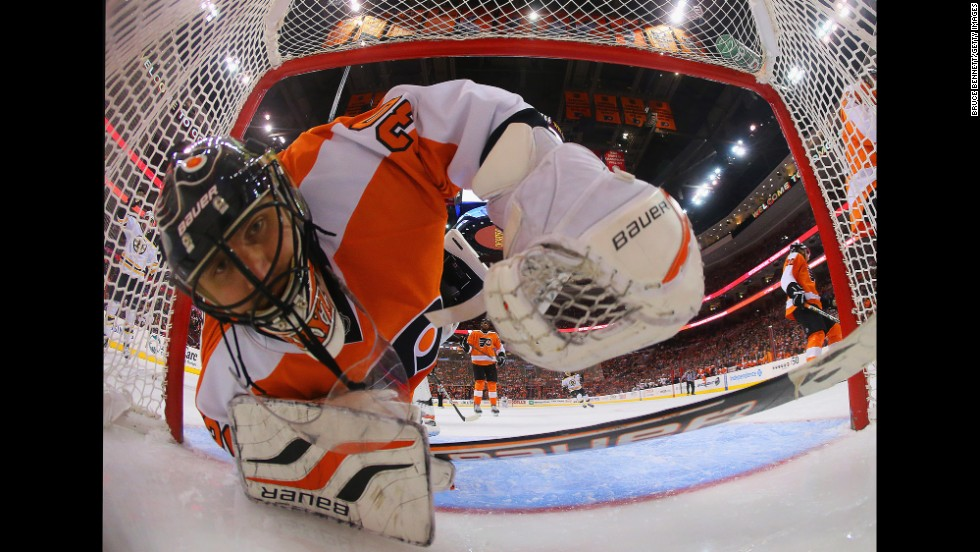 Ilya Bryzgalov of the Philadelphia Flyers looks back in the net after a goal by Nathan Horton of the Boston Bruins on March 30 in Philadelphia, as seen through a wide angle lens. The Flyers defeated the Bruins 3-1.