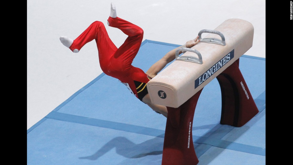 Gymnast Daan Kenis of Belgium falls off the pommel horse during the qualification round for the World Artistic Gymnastics Championships in Antwerp, Belgium, on September 30.