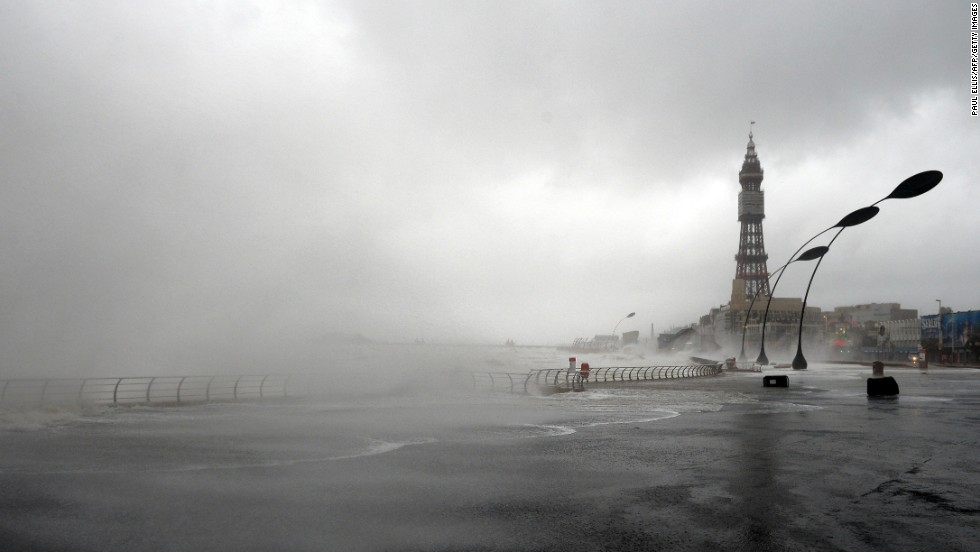 The tide rushes over a sea wall in Blackpool, England, on December 5.