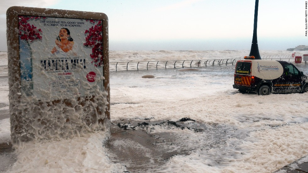 The tide turns to froth December 5 on the Blackpool promenade.