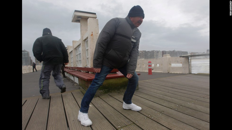 People fight against strong winds on a pier in Blankenberge, Belgium, on December 5.