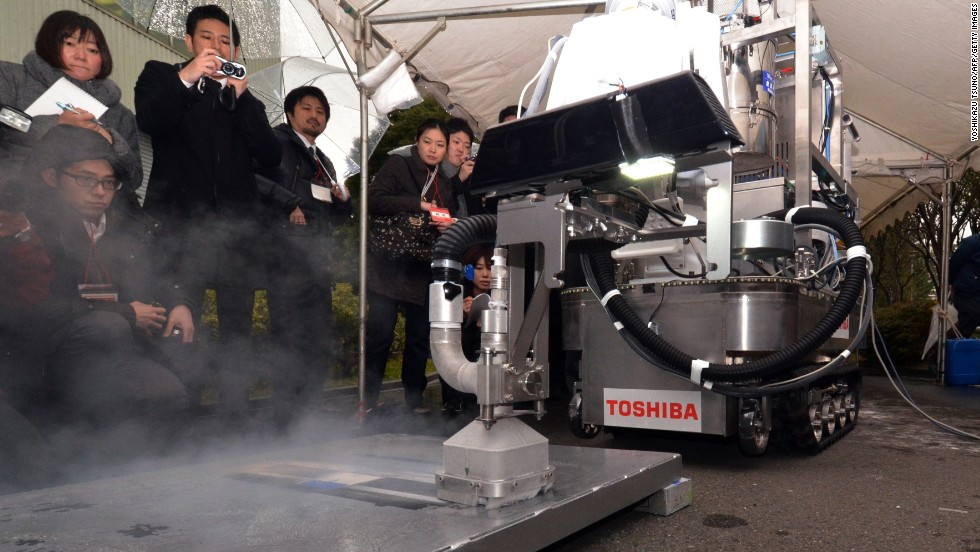 This Toshiba decontamination robot blasts dry ice particles against contaminated floors or walls and can be used to quickly and effectively clean up chemical spillages at nuclear plants.