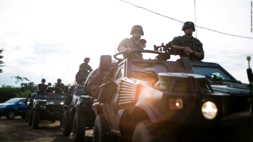 French military forces drive in Cameroon on December 5.