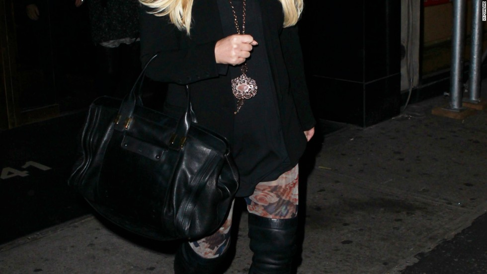 Jessica Simpson's boots are made for walking the streets of New York City on December 5.