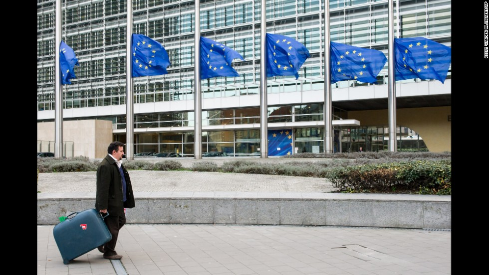 European Union flags fly at half-staff at the European Commission headquarters in Brussels, Belgium, on December 6.