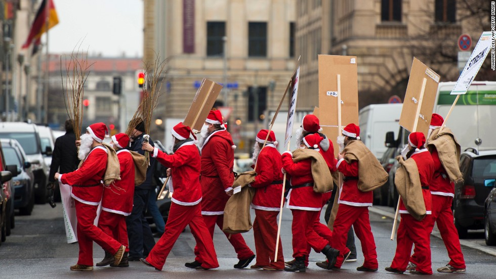 "Inkota activists dressed as Santa Claus demonstrate in support of the ""Make Chocolate Fair!"" campaign on December 5 in Berlin. The campaign promotes fair-trade chocolate and better working conditions for cacao farmers in Africa."