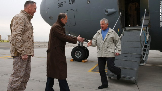 U.S. Secretary of Defense Chuck Hagel (R) arrives on a C17 Military aircraft, on December 7, 2013 in Kabul, Afghanistan.