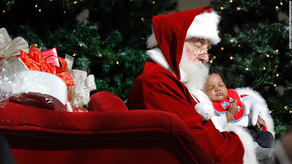 Santa and 2-month-old Ty'e Fishe have their picture taken November 29 at Lakeside Mall in Metairie, Louisiana.