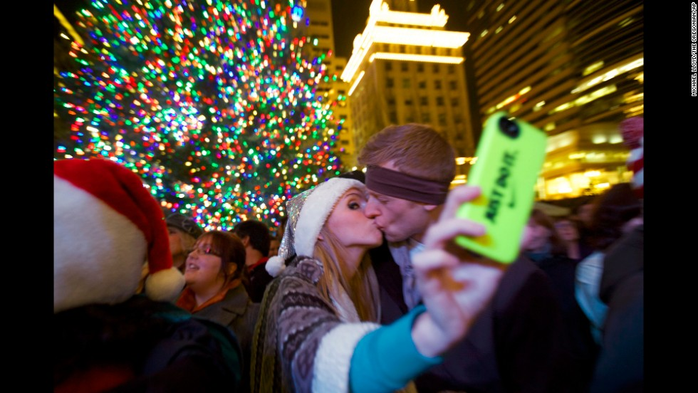 Savannah Rice snaps a picture with her boyfriend November 29 at Pioneer Courthouse Square in Portland, Oregon.