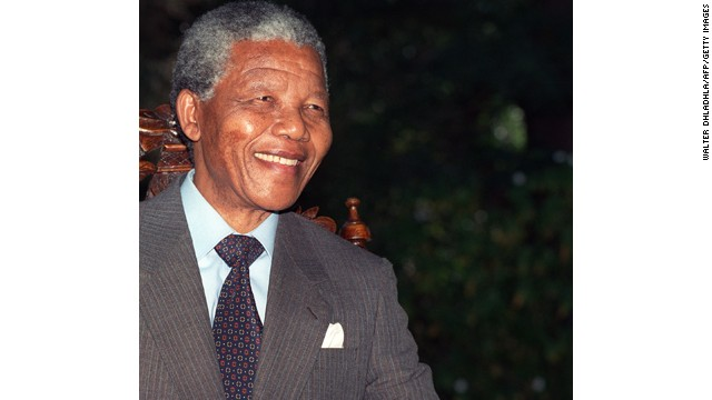 Anti-apartheid leader and African National Congress (ANC) member Nelson Mandela smiles during a photo session after his first press conference since his release from jail, 12 February 1990 in Cape Town. (Photo credit should read WALTER DHLADHLA/AFP/Getty Images)