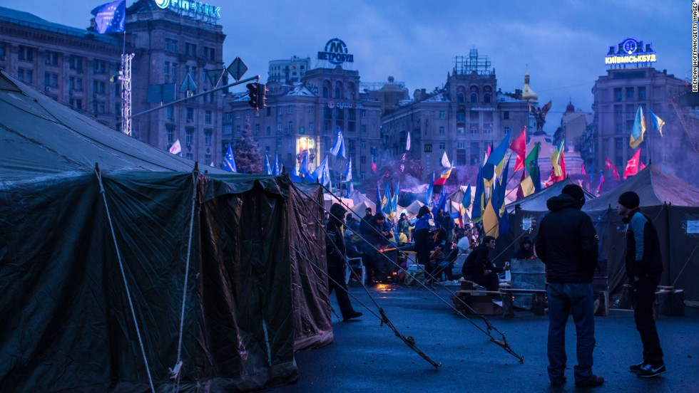Anti-government protesters camp in Independence Square early in the morning on December 8.