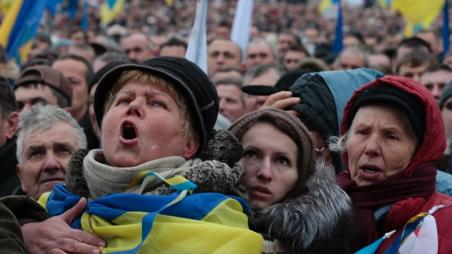 Pro-European Union activists shout slogans during a rally in Independence Square in Kiev, Ukraine, on December 8. Over 100,000 Ukrainians participated in the rally.