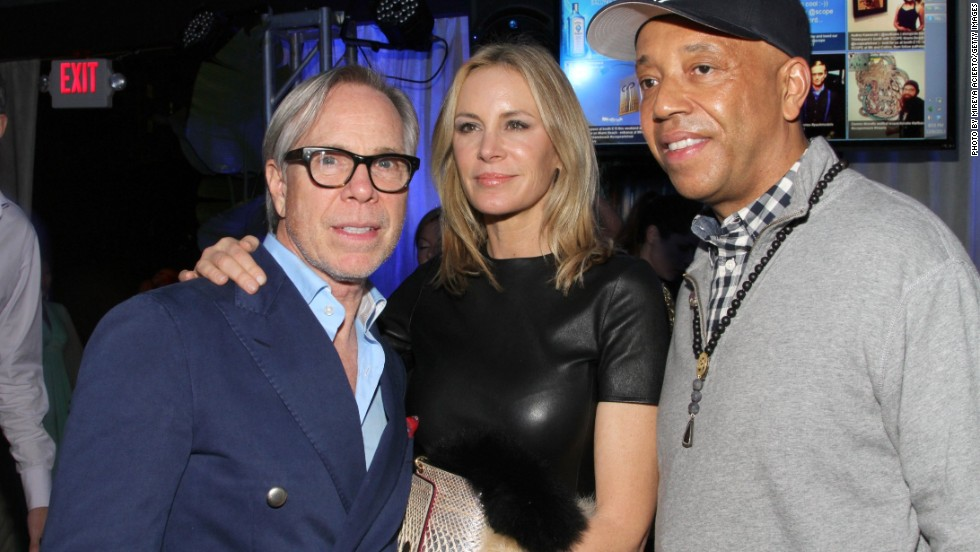 "In 2011 fashion designer Tommy Hilfiger acquired a Damien Hirst work entitled ""Disintegration -- The Crown of Life"" for $1.4 million. Here Hilfiger and his wife mingle with Russell Simmons at an Art Basel event hosted by Bombay Sapphire."