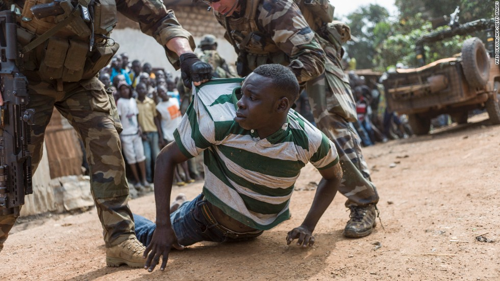 French soldiers arrest an alleged ex-Seleka rebel in a neighborhood near the Bangui airport on December 9.