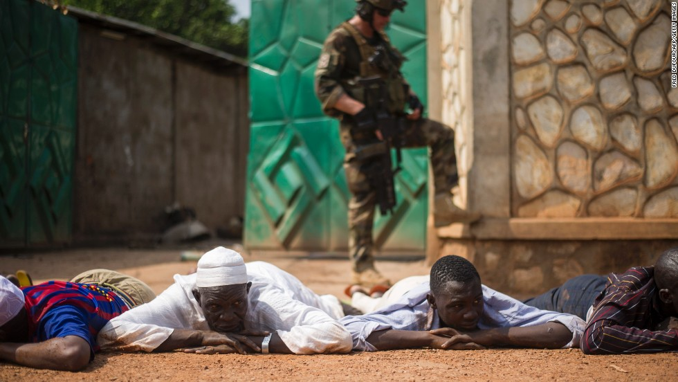 A French soldier stands guard after the arrest of ex-Seleka rebels in a neighborhood near Bangui's airport on December 9.