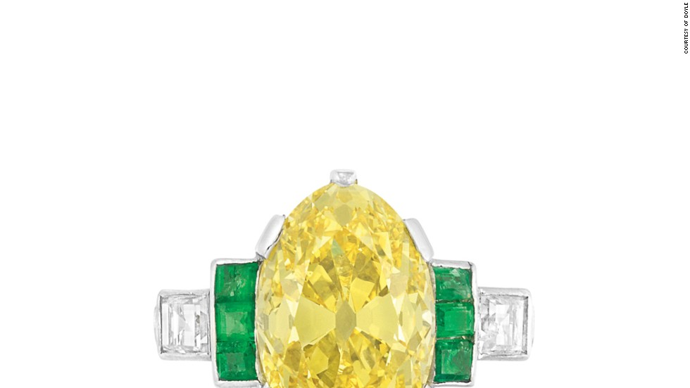 "The period between the two world wars saw a fashion for colorful gems, such as this platinum fancy vivid yellow diamond and emerald ring which will be auctioned off at <a href=""http://www.doylenewyork.com/"" target=""_blank"">Doyle New York</a>."