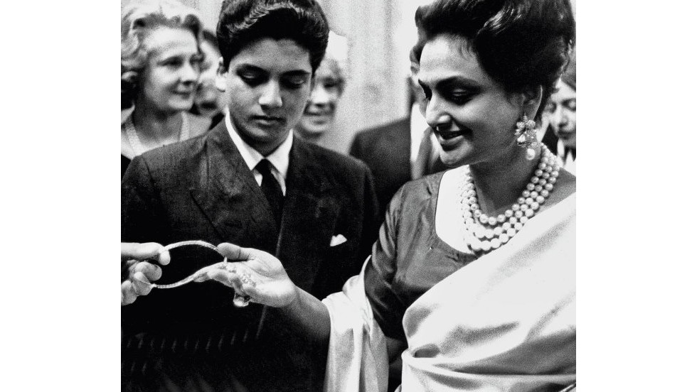 "The Maharani Sita Devi of Baroda lived the life of indulgent extravagance, and amassed a spectacular collection of jewelry. Here she is with her son at Van Cleef & Arpels in 1960 admiring the famous ""Princie"" diamond from Golconda mines that was named after him, and sold by Christie's in April for record breaking $39.3m."