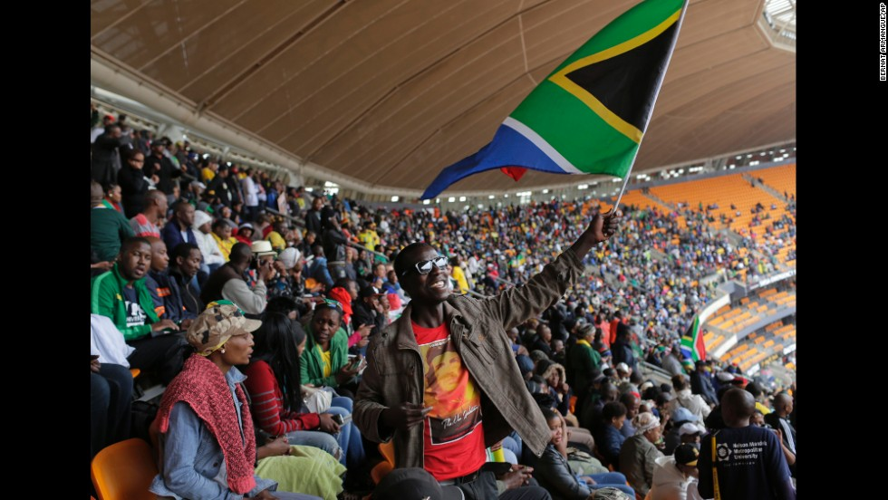 A man waves a South African flag at FNB Stadium.