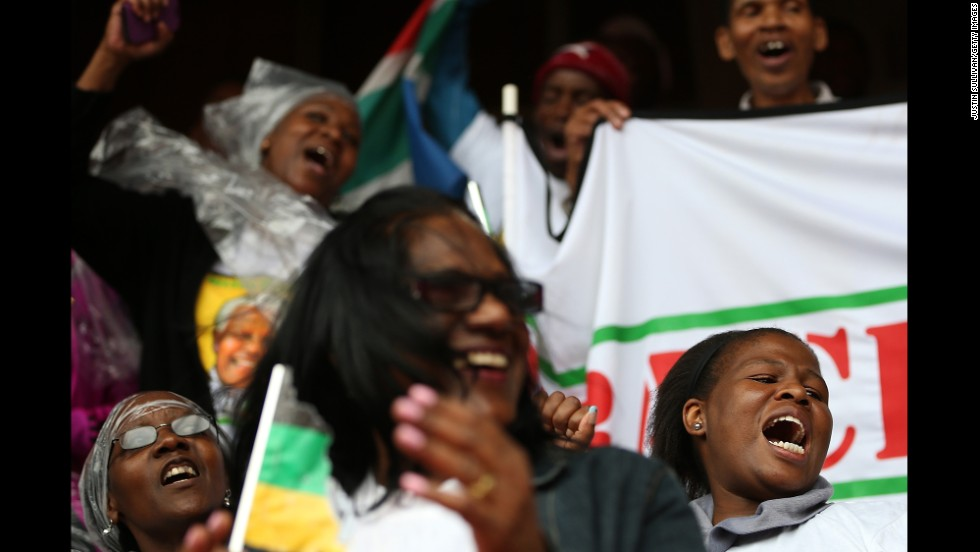 People sing and dance at Ellis Park in Johannesburg.