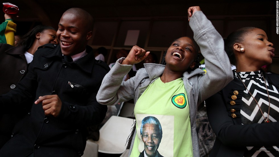 People celebrate Mandela at a telecast of the memorial service at Ellis Park in Johannesburg.